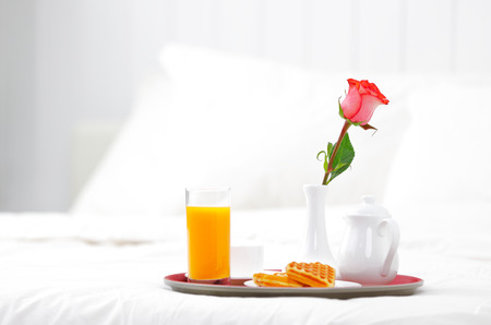 Photo for romantic breakfast in bed and flower rose - Royalty Free Image