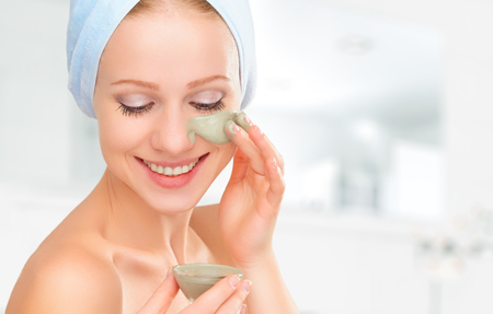 Photo pour beautiful girl in the bathroom and mask for facial skin care - image libre de droit