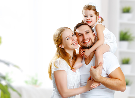 Foto de happy family mother, father,  child daughter at home - Imagen libre de derechos
