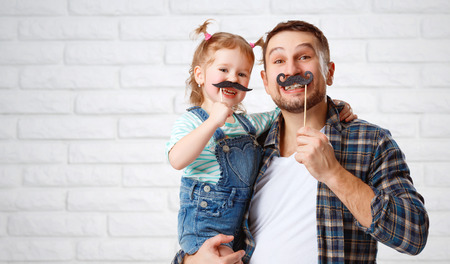 Photo pour funny family father and child daughter with a mustache - image libre de droit