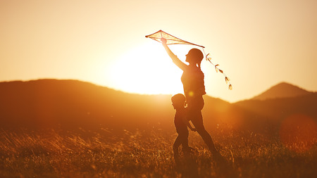 Photo pour happy family mother and child run on meadow with a kite in the summer on the nature - image libre de droit