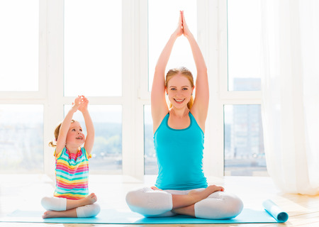 Photo for family mother and child daughter are engaged in meditation and yoga, exercise at home - Royalty Free Image