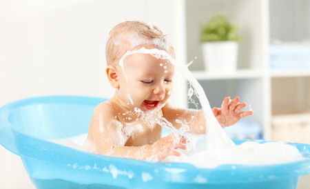 Photo for A Happy toddler bathing in bathtub - Royalty Free Image