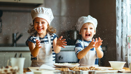 Photo pour happy family  funny kids are preparing the dough, bake cookies in the kitchen - image libre de droit
