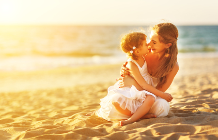 Photo for happy family at the beach. mother hugging baby daughter at sunset - Royalty Free Image