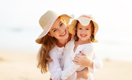 Photo pour happy family at the beach. motherand child daughter hug at sunset - image libre de droit