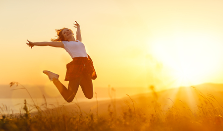 Photo pour Happy woman   jump,  rejoices, laughs  on sunset in nature - image libre de droit