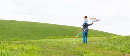 Photo pour happy family father and baby daughter run with a kite on meadow - image libre de droit
