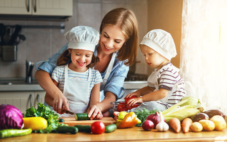 Photo for Healthy eating. Happy family mother and children  prepares   vegetable salad in kitchen  - Royalty Free Image