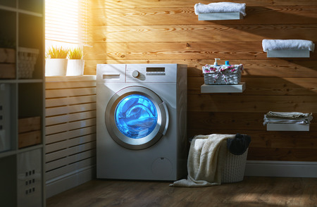 Foto de Interior of a real laundry room with a washing machine at the window at home - Imagen libre de derechos