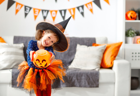 Photo for happy laughing child girl in witch costume to halloween  - Royalty Free Image