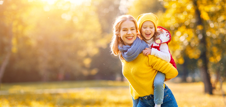 Photo for happy family mother and child daughter playing and laughing on   autumn walk   - Royalty Free Image