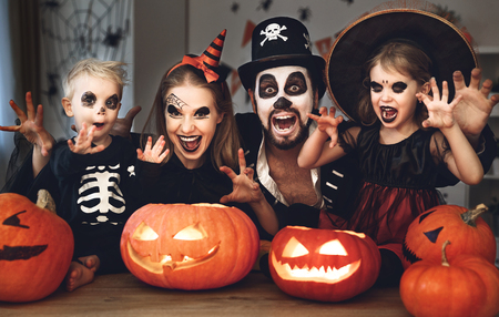 Foto de happy family mother father and children in costumes and makeup on a celebration of Halloween  - Imagen libre de derechos