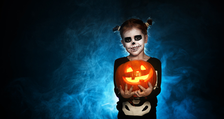 Photo for magic skeleton with a pumpkin. baby girl in costume to halloween - Royalty Free Image
