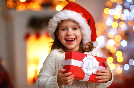 Photo for happy laughing child girl with christmas present at home - Royalty Free Image