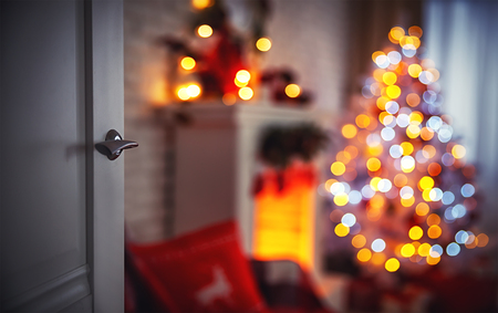 Photo for Christmas interior with a Christmas tree fireplace and  open door - Royalty Free Image