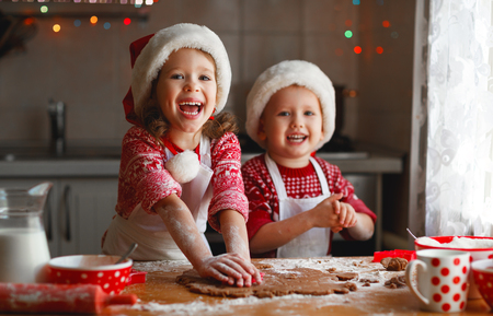 Photo for happy funny children bake christmas cookies - Royalty Free Image