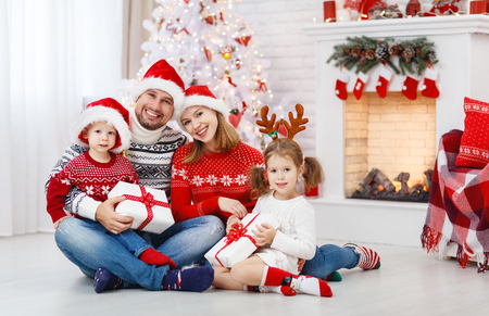 Foto de happy family mother father and children at home on Christmas morning - Imagen libre de derechos
