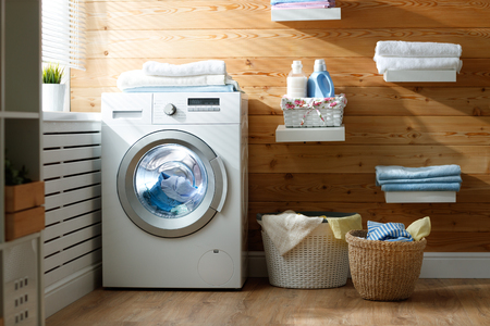 Photo for Interior of a real laundry room with a washing machine at the window at home  - Royalty Free Image