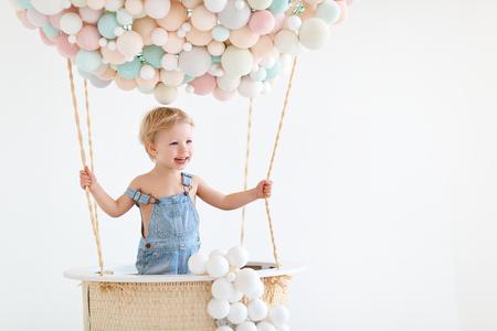 Foto de cute happy baby boy in a fairy magic hot air balloon  - Imagen libre de derechos