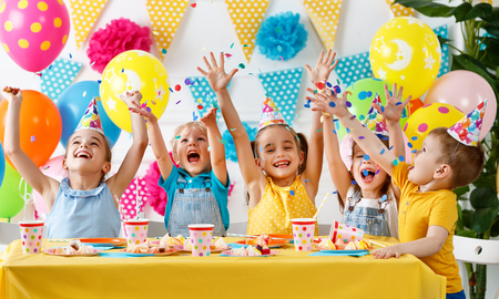 Foto de Children's birthday. happy kids with cake and balloons - Imagen libre de derechos