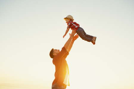 Photo pour Father's day. Happy family father and toddler son playing and laughing on nature at sunset - image libre de droit
