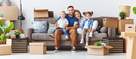 Foto per happy family mother father and children move to a new apartment and unpack boxes - Immagine Royalty Free