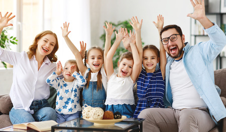 Foto de Happy large family mother, father and children sons and daughters at home - Imagen libre de derechos
