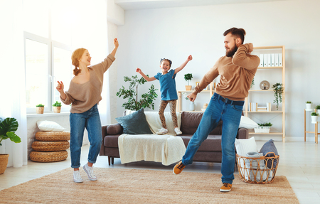 Photo pour happy family mother father and child daughter dancing at home - image libre de droit