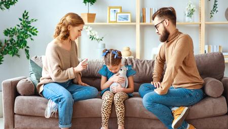 Foto de A family quarrel divorce parents and child swear, conflict - Imagen libre de derechos