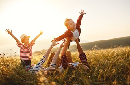 Photo pour Happy family: mother, father, children son and  daughter on nature  on sunset - image libre de droit