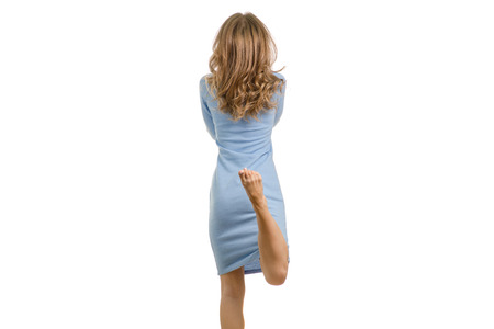 Photo pour Young woman in dress rear view on white background isolation - image libre de droit