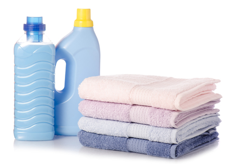 Photo for A stack of towels softener conditioner liquid laundry detergent on white background isolation - Royalty Free Image