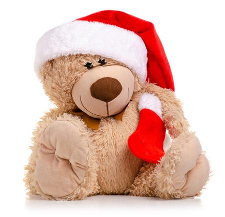 Foto de Christmas toy bear with Santa hat isolated on a white background. - Imagen libre de derechos
