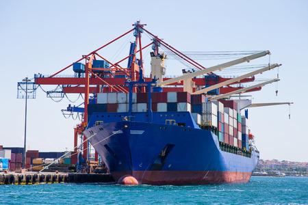 Foto de Container Ship is loading in a port - Imagen libre de derechos