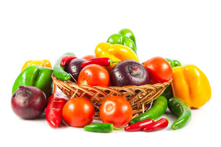 Fresh vegetables in basket isolated on white. Bio Vegetable.  Composition with raw vegetables and basket isolated on white
