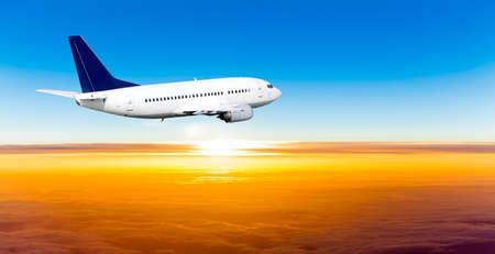 Foto de Airplane in the sky at sunset. A passenger plane in the sky - Imagen libre de derechos