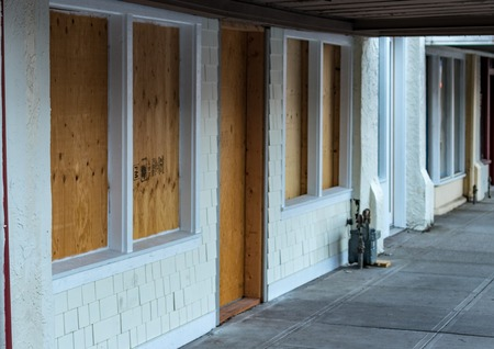 Photo for Retail storefront closed and boarded up with plywood - Royalty Free Image