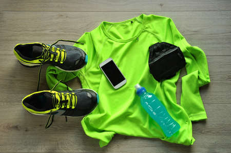 Foto de Clothes make running with isotonic drink, phone and T-shirt - Imagen libre de derechos