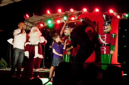 Kids and Lord Graham Brisbane Mayor turn on the light of Christmas tree