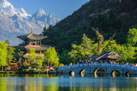 Photo for Lijiang old town scene-Black Dragon Pool Park. you can see Jade Dragon Snow Mountain in the background. - Royalty Free Image