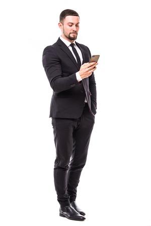 Foto de Young bearded business man typing message on smartphone touch screen. - Imagen libre de derechos
