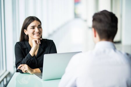 Photo pour Two business partners discussing new project and sharing ideas, young serious recruiter woman listening to male candidate during job interview - image libre de droit
