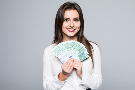 Foto de Young woman holding euro money isolated on white - Imagen libre de derechos