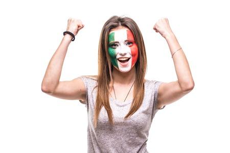 Foto de Pretty woman supporter fan of Mexico national team painted flag face get happy victory screaming into a camera. - Imagen libre de derechos