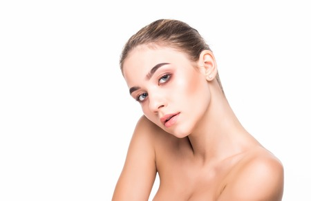 Photo pour Portrait of young beautiful woman touching her face isolated over white background. Cleaning face, perfect skin. SPA therapy, skincare, cosmetology, hair removal or plastic surgery concept - image libre de droit