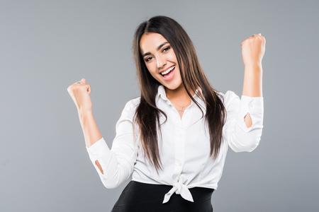 Foto de Successful businesswoman with arms up over a white background - Imagen libre de derechos
