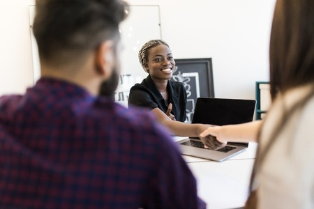 Photo for African american hr team welcoming female applicant at job interview, diverse businesswomen shaking hands at multi ethnic group meeting, handshaking and good first impression, teamwork introduction - Royalty Free Image
