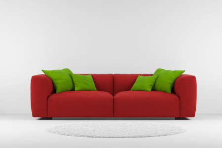 Foto de Red couch with carpet and green pillows - Imagen libre de derechos