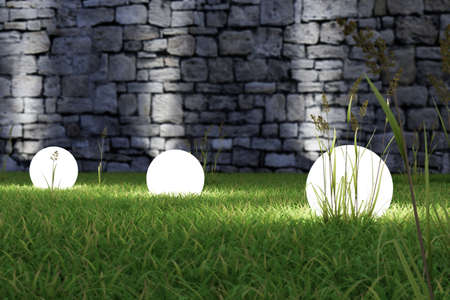 Photo for Glowing light in the grass with old wall in background - Royalty Free Image